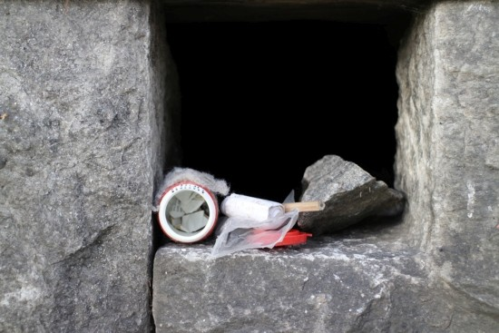 geocache in old house stone foundation